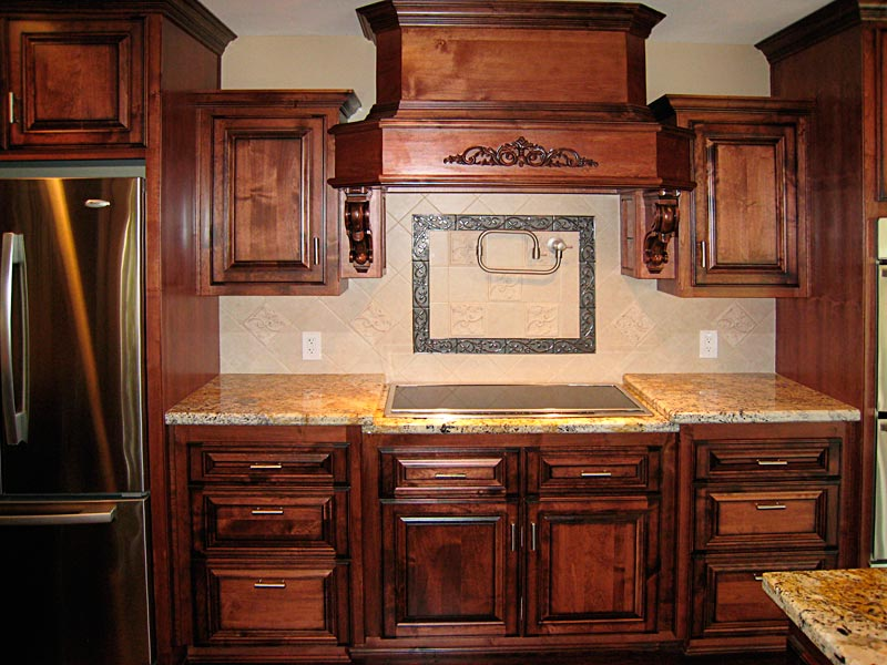 Carved kitchen cabinets door panel choices by carved for Carved kitchen cabinets